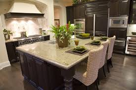 countertops dark wood kitchen islands table: dark wood cabinet luxury kitchen with large granite dining island