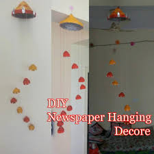 How To Make A Wind Chime Newspaper Craft Ideas Diy Wind Chime Newspaper Wall Decor