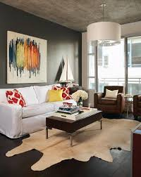 Try contrasting dark wood floors with a pale cowhide rug to highlight their  rich color.