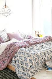 echo boho chic bedding blue mauve and white printed tassel pillows gypsy inspired ideas