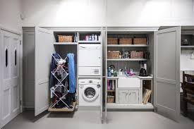 proving that you don t need a dedicated utility room burlanes interiors stacked laundry appliances to allow space for a pull out drying rack