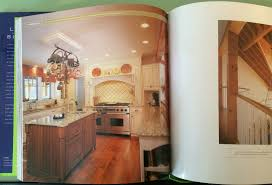 rich warm country kitchen is composed of granite tile hardwoods and commercial stainless steel