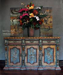 iron wall decor u love: idea add a punch of turquoise and orange to the tuscan dining room with the santa cruz buffet and madeira wall art find the colors you love to love at