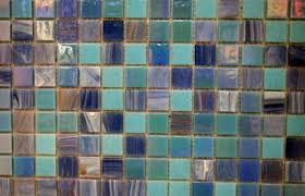 seal the grout around glass tiles to keep the installation looking new