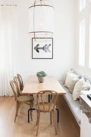 DINING: gorgeous monochrome dining space with timber table and timber  bentwood chairs + built in