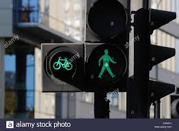 Pedestrian Light Crossing Green Man Pedestrian And Cycle Crossing Signal At Traffic