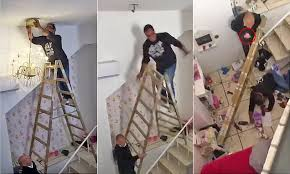 diyer drops a chandelier and tumbles from his ladder in farcical daily mail