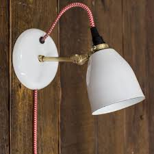 lovell porcelain plug in wall sconce