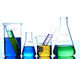 beakers with diffe colored against white background
