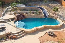 Luxury Backyards traditional-pool