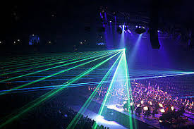 lighting for pictures. Low-intensity Lighting And Haze In A Concert Hall Allows Laser Effects To Be Visible For Pictures