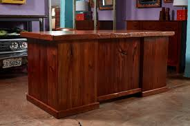 this one is made from reclaimed pine and the flooring of an old bowling alley