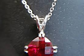 sterling silver chain and red stone pendant multi faceted rich red stone