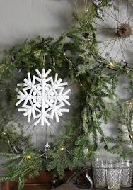 This charming, rustic, home-style driftwood snowflake ornament is ...