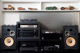 sound system components. a hi-fi sound system underneath shelf lined with vintage toy cars components s