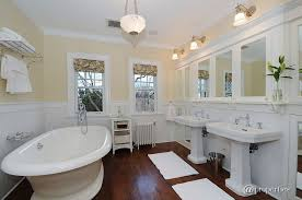 bathroom chair molding. traditional full bathroom with hardwood floors, chair rail, fresh white 3 in. x molding n
