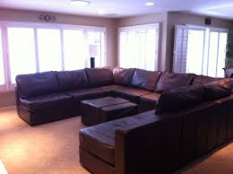 U Shaped Couch Living Room Furniture 6s Glove Leather U Shaped Couch Set Up With A Matching Ottoman In
