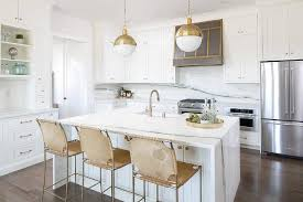white center island with gold suede counter stools