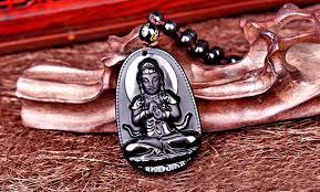 jade buddha pendant meaning