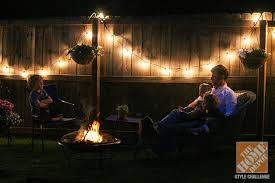 simple patio decorating ideas enjoying the backyard by the light of string lights and a