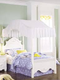 image of lovely white custom wooden bed with cool canopy bed curtains
