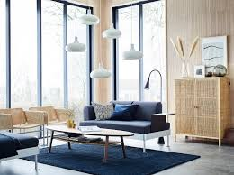 sitting room furniture. Simple Room A Lightfilled Beige Blue And Grey Living Room With Large Windows A With Sitting Room Furniture O