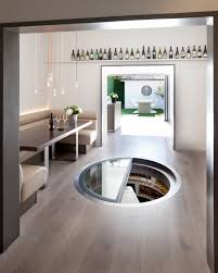 retractable round glass trap door spiral cellars