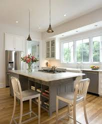 kitchen island with stove top and seating unique open and airy kitchen with seating around a