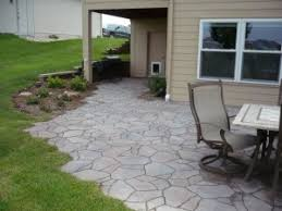 you will notice that the shape of patio to left has been designed look like stamped pieces stone are unevenly placed giving it a more poured concrete natural looking t25 patio