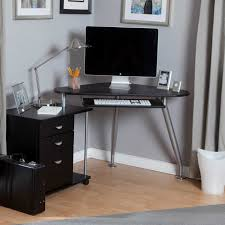 narrow corner computer desk for small workspace with black file cabinet