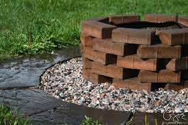 this quick and simple project uses patio pavers and finishing stones to update a not so pretty firepit into a pretty and easy diy firepit