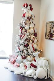 How to Create Your Own Winter Wonderland How to Decorate a Christmas Tree  101 Flocked Christmas Tree The Everyday Hostess Red and White Christmas Tree