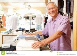 male s assistant at checkout of clothing store royalty male s assistant at checkout of clothing store