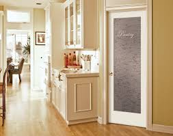 kitchen white wooden pantry cabinet with transpa glass door on white wall and laminate flooring