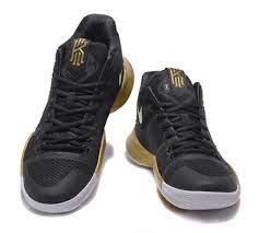 Amazon.com: Men's Kyrie Irving Shoes Kyrie 3 Basketball Shoe - Black/Gold:  Books