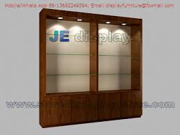 High Display Cabinet in wall by Wood veneer lacquer with Glass ...