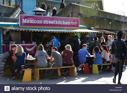 mexican restaurant people. Beautiful Mexican People Sitting On Benches Eating Outside A Mexican Restaurant The  Southbank In London England Throughout Restaurant