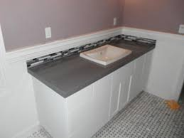 gray bathroom with white cabinets. grey ceasarstone countertop with carrera marble floor gray bathroom white cabinets