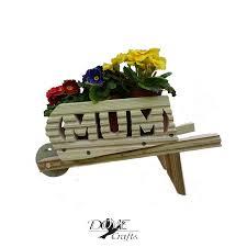wheelbarrow planter mum small