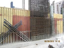 shear wall. as the photos demonstrate, there are heavily reinforced areas within shear walls. beam in center of has 32 #11 bars, 21 feet long, wall