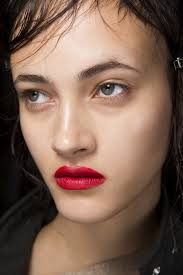 meanwhile simone rocha debuted a punchy cherry coloured lip which stood out against an otherwise no makeup