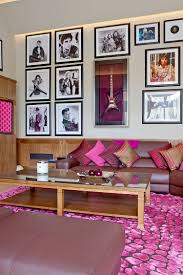 Living Rooms:Pink Living Room With Leather Sofa And Glass Coffee Table On  Pink Patterned