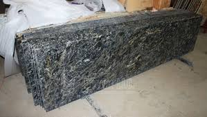 it s a luxury granite from brazil with golden vein distribute throughout the slab we provide standard prefab kitchen counter tops or customized worktops