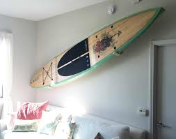 wall racks for storing paddle boards