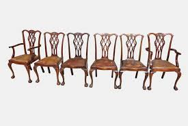 a set of 18 mahogany pendale style pierced splat back dining chairs with cabriole legs ending