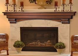 auburn fireplace mantel decor with candles above shelf