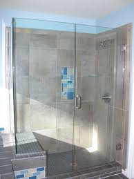 after photo of shower with glass tile shelves ceramic tile surround and frameless glass shower done by sdy glass