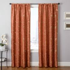 cleopatria in rust pumpkin orange color embroidery pattern with flowers and vines curtains in