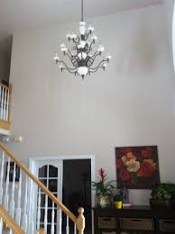 An unexpected way to dress tall walls is to use textiles. Tall Ceilings Large Wall Space How To Decorate