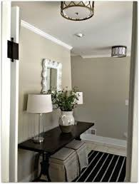 entry lighting styling your entry nate berkus rug allen roth light fixtures n9